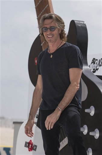 Actor Rick Springfield poses for photographers to promote his upcoming film